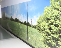 Picture of part of the memory corridor - the wall is lined with a picture showing a field and trees
