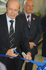 Two male dignitaries cutting a ribbon at the opening of the memory corridor