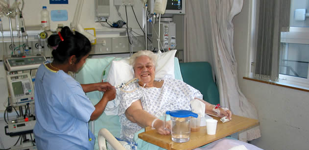 nurse attending patient in a hospital bed