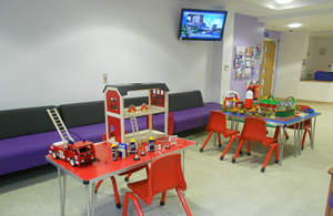 Picture showing the interior of the childrens area various toys etc and seating area