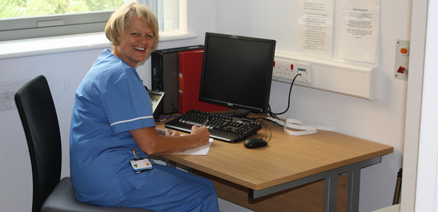 Nurse seated at a computer