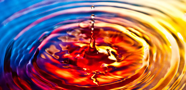 Picture of ripples in water lit colourfully