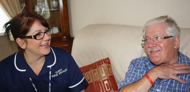 Nurse specialist talking with  male patient