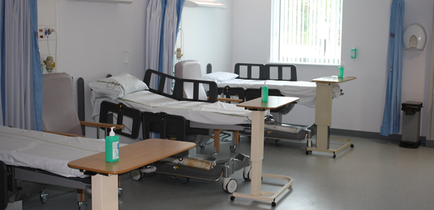 Picture showing three empty hospital beds