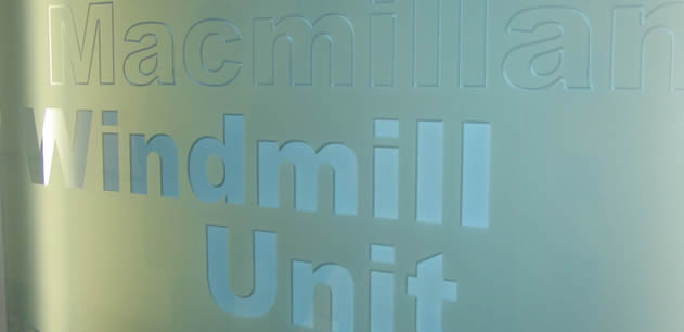 "picture of a sign, text reads ""Macmillan Windmill Unit"""