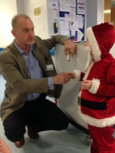 A doctor meets a boy dressed as Santa