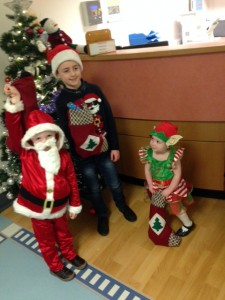 Three young children in festive clothing