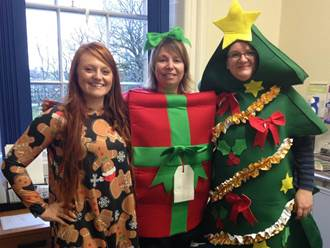 Three women in festive clothing