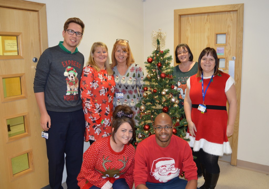 Pharmacy staff in their Christmas jumpers