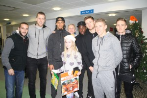 Young supporter Suranne Halliday from Fleetwood meets her Blackpool FC favourites at Blackpool Victoria Hospital.