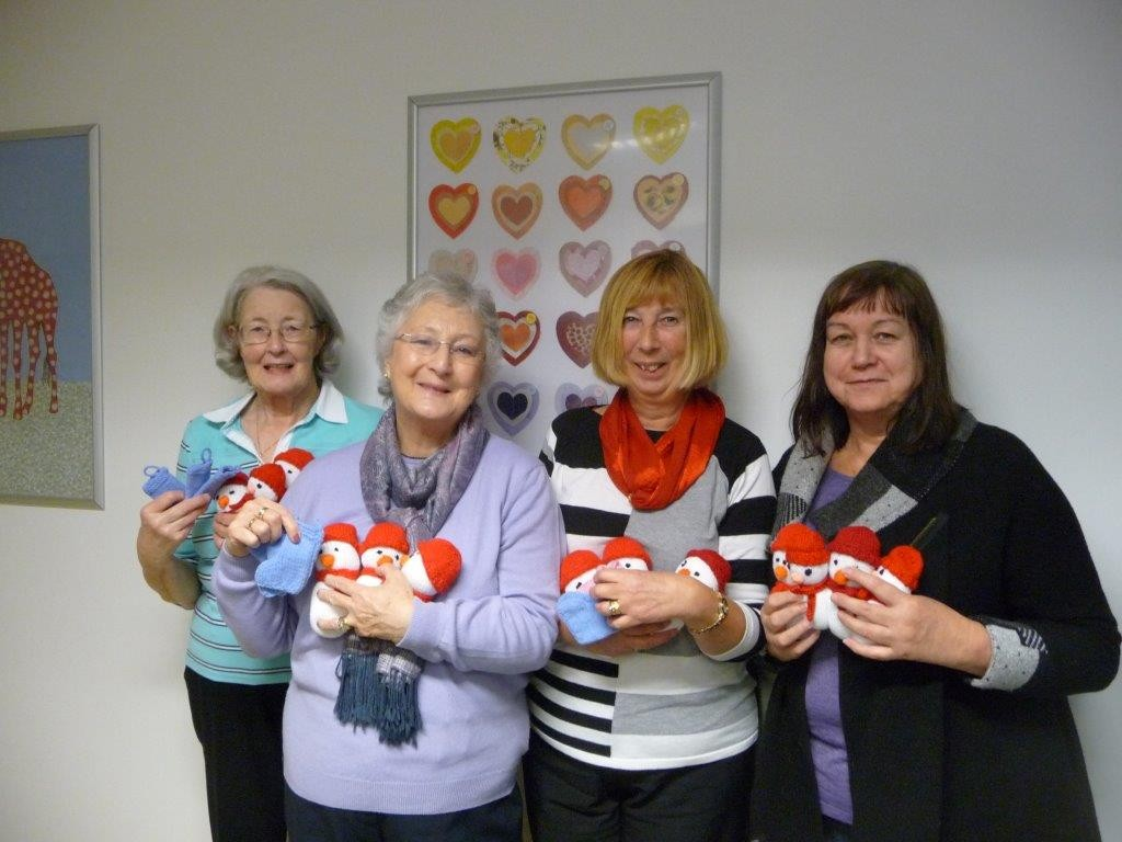 Members of the Blackpool, Fylde and Wyre branch of the NHS Retirement Fellowship with some of their knitted gifts