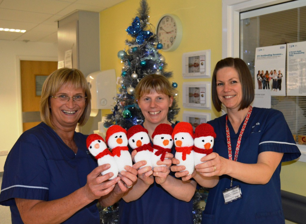Liz Morrison, Advanced Neonatal Nurse Practitioner, Sarah Heydon, Sister on the Neonatal Unit and Amy Gregory, Sister on the Neonatal Unit, with knitted snowmen for babies on the unit