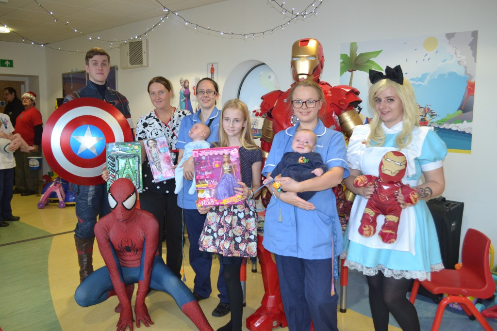 children and nurses with three superheroes spiderman iron man and captain america
