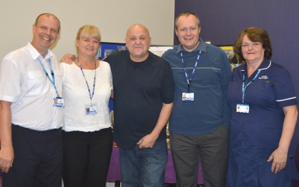 Tommy Whitelaw (centre) with staff at Blackpool Victoria Hospital