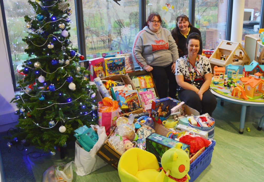 Michelle and Sue with Rosanne and some of the toys they delivered.