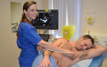 A medic using heart monitoring equipment