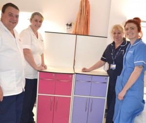 Four members of staff with a coloured wardrobe