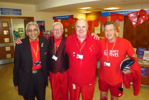 Four men in red t-shirts