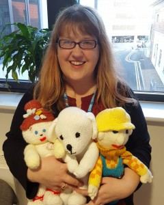 A woman with three soft toys