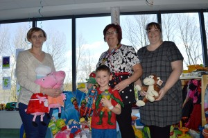 Three women and a boy with lots of toys