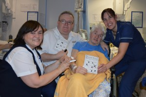 Three medical staff with a patient