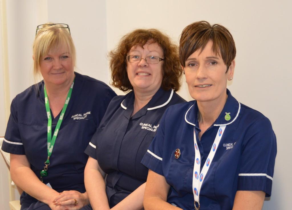 Three nurses in uniform.