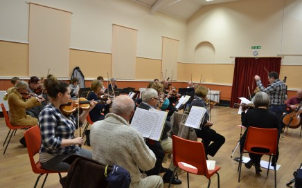 An orchestra rehearsing