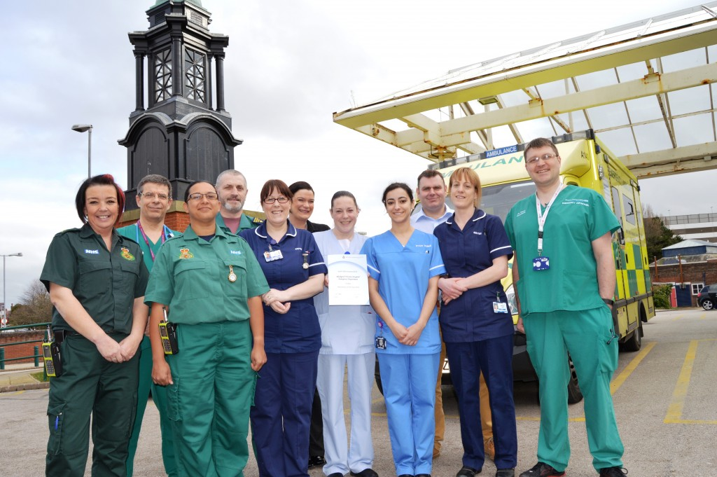 A group of people standing next to an ambulance