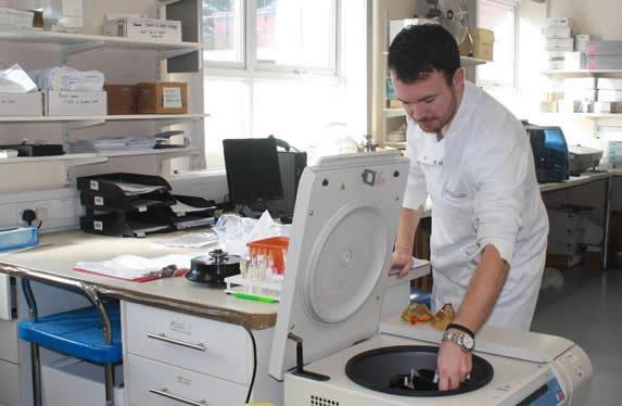 Biochemistry Staff member using equipment