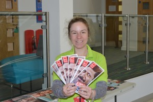 A woman with lots of leaflets