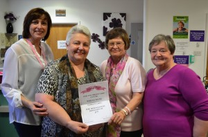 Shirley Carte, second left, presents the money she raised to Rena Shanahan, left, Ruth Boardman and Clinical Nurse Specialist Sarah Guilfoyle