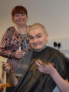 Daniel Brandwood having his hair off shaved by Paula Hornby