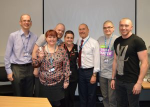 The team in the Pathology department after their hair was shaved off