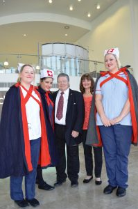 Johnnie Casson with singer Anne Nolan and nurses in 'vintage' uniforms at the event at Blackpool Victoria Hospital