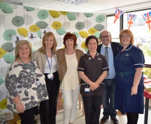 Mick and hospital supporters judging the dementia awareness displays at Clifton Hospital