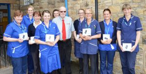 Chris Rabbett with some of the district nurses and their new cameras