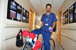 Robert Foster festoons his bike with bras to promote his 120 mile challenge