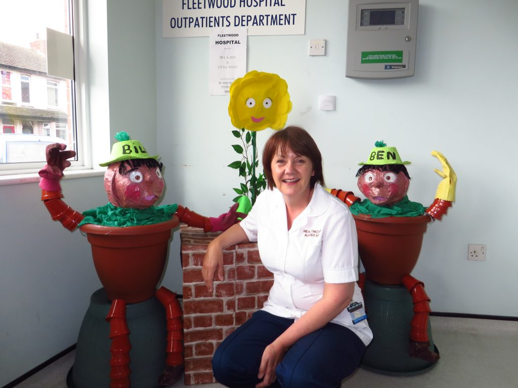 Pam Stephenson, a healthcare assistant for Blackpool Teaching Hospitals, with the Bill and Ben scarecrows at Fleetwood Hospital