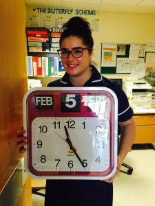 Fran Hall with a special clock designed to make life easier for people living with dementia