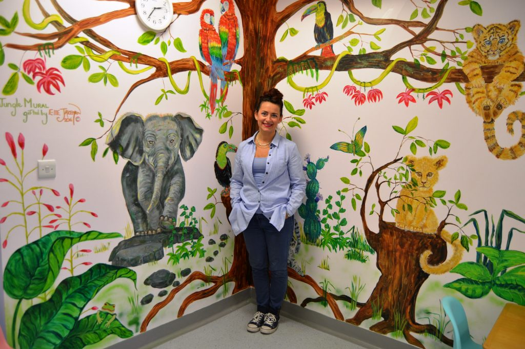 Ellie Jakeman and her mural at Clifton Hospital