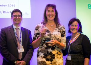 Veronica Southern, centre, receives her award from Juliette Kumar, Innovation Agency Associate Director for Improvement and Education and Gary Leeming, Director of Informatics, Greater Manchester Academic Health Science Networks