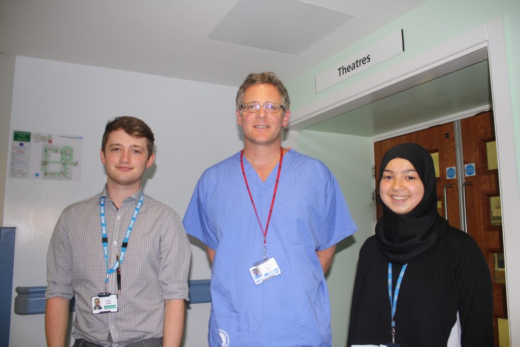 Medical students Daniel James and Mariam Gaddah with Cardiothoracic Consultant, Mr Antony Walker, at Blackpool Victoria Hospital.
