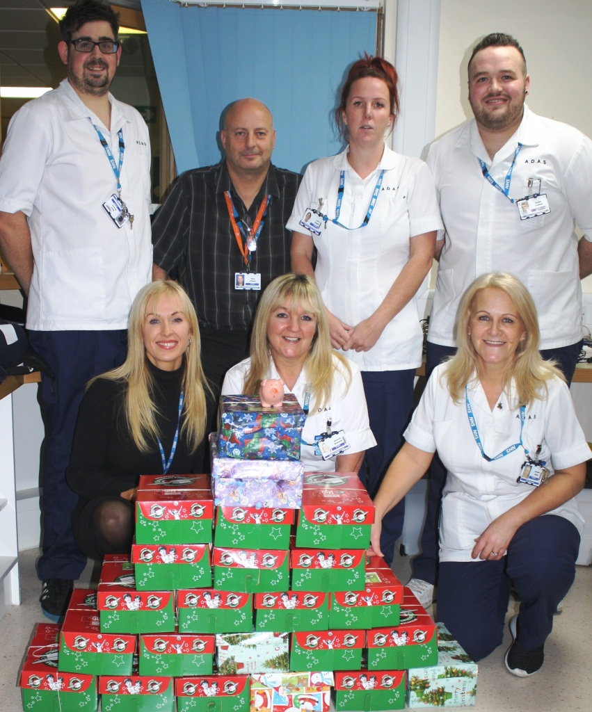 Staff from the team with the shoeboxes