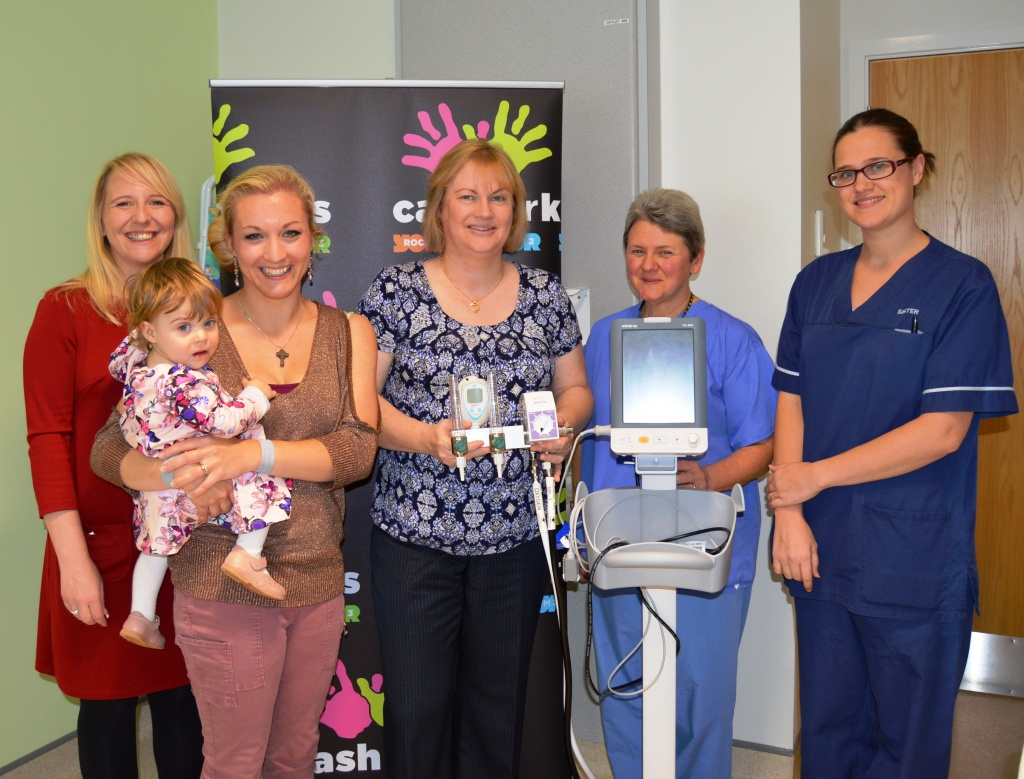 Charity Manager for Cash for Kids, Nikki Thompson; Sarah Schofield with Sophie, Neonatal Ward Manager, Catherine Nash; Staff Nurse Anita Payne and Sister Katie Lander with the new equipment