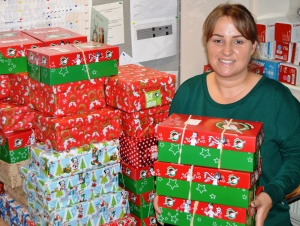 Danielle Perrett with some of the shoeboxes she has collected as part of the Operation Christmas Child appeal