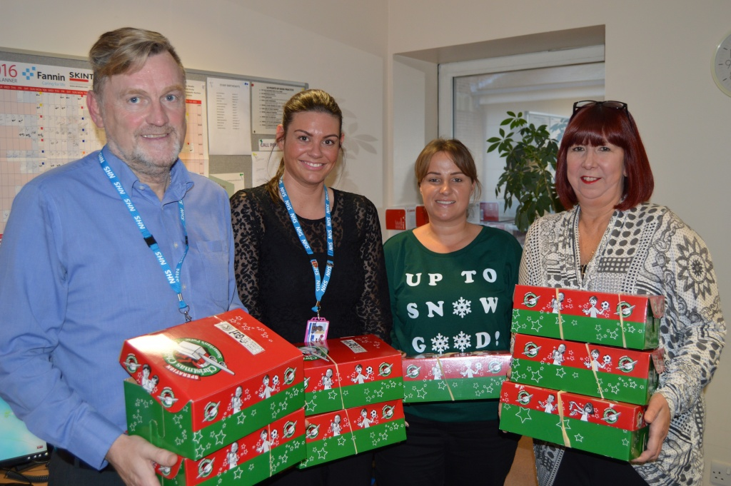Danielle Perrett with switchboard staff and shoeboxes at Blackpool Victoria Hospital