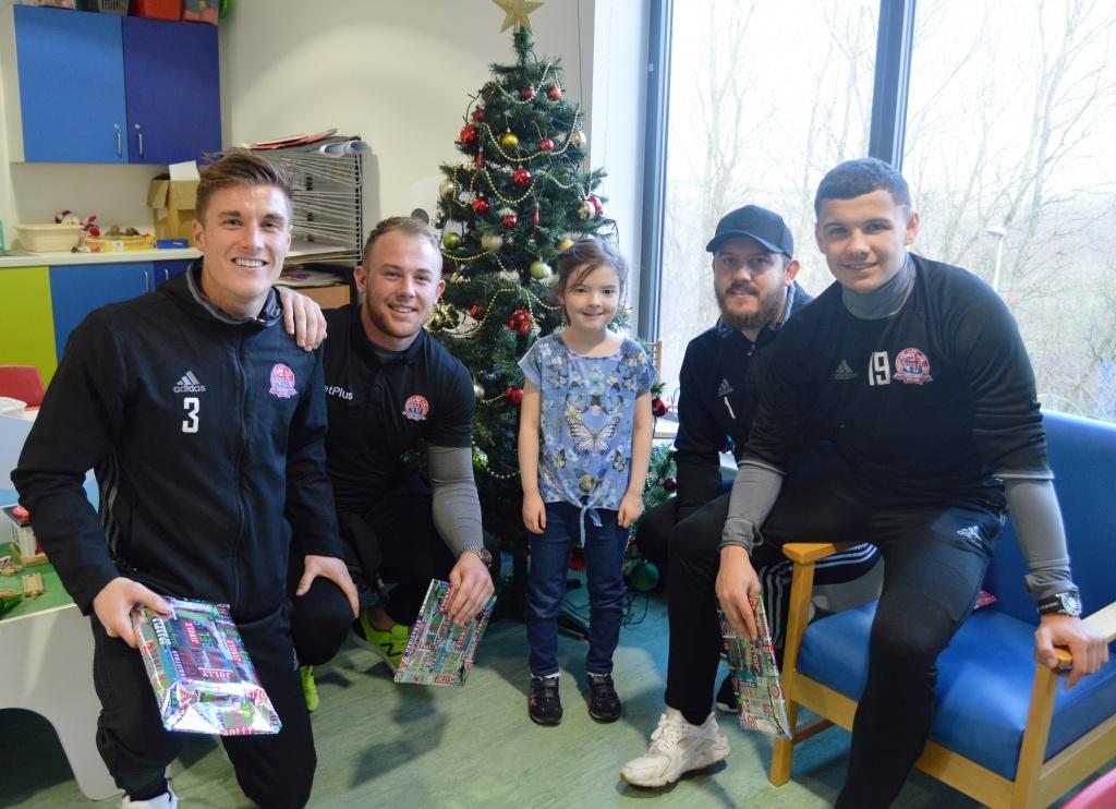 AFC Fylde's Dan Bradley, Rhys Taylor, Tony Thompson and Macauley Wilson with Alexis Fowler