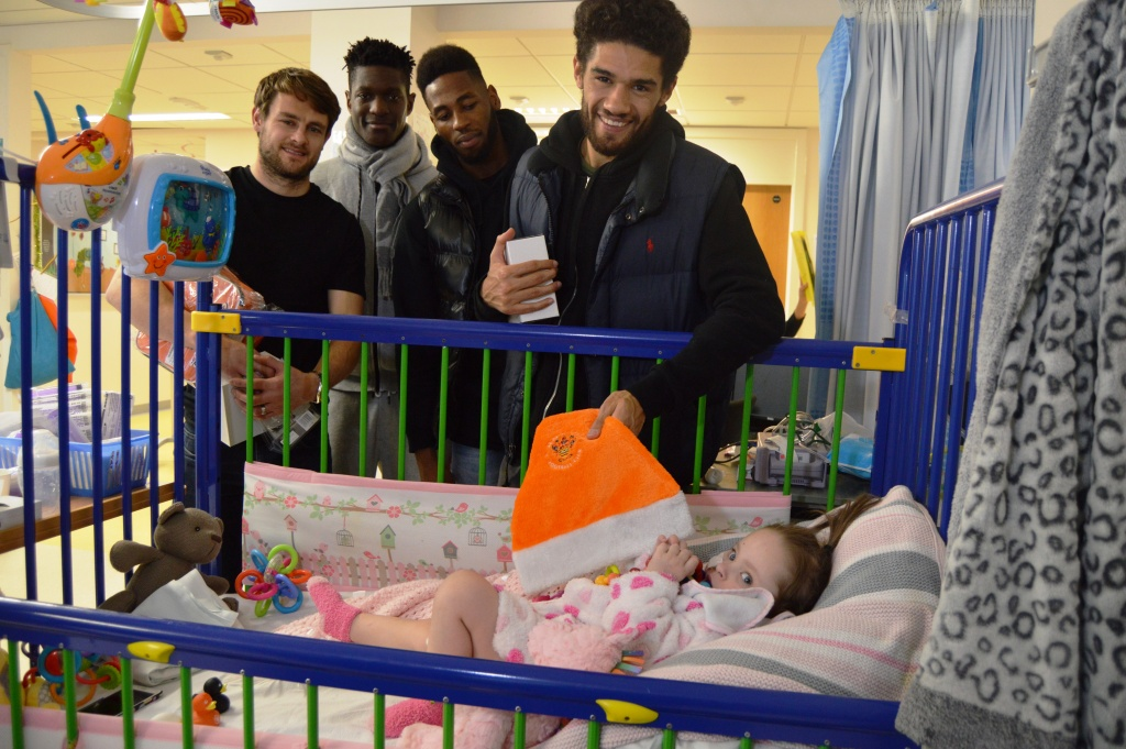 Blackpool footballers Andy, Armand, Jamille and Kelvin with Lexi-Rose