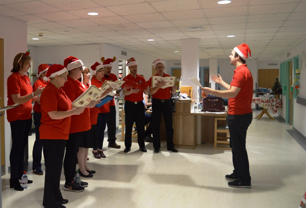 The choir sing on Ward 1
