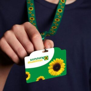 A sunflower lanyard and badge